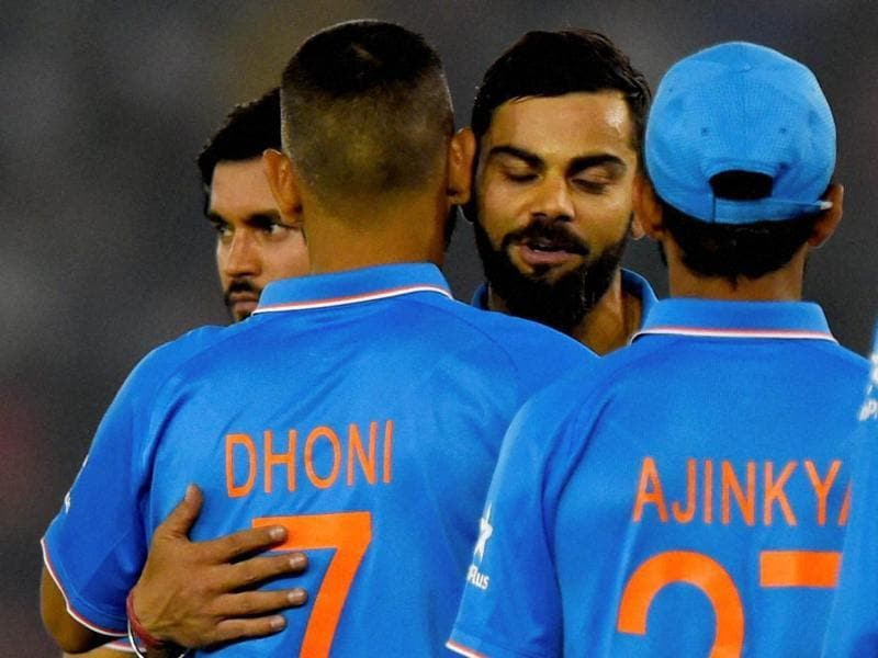 Kohli and Dhoni exchange a hug after India's win. (PTI)
