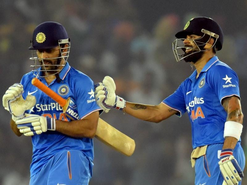 Virat Kohli congratulates MS Dhoni after the latter completed his half-century during the third ODI against New Zealand at the IS Bindra Cricket Stadium in Mohali on October 23, 2016. Kohli and Dhoni's 151-run partnership took India to a 7-wicket win. (Keshav Singh/HT Photo)