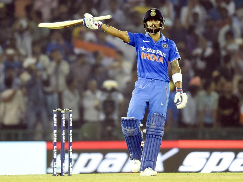 Kohli raises his bat and twirls it around his head in celebration after reaching the 150-run mark. (Keshav Singh/HT Photo)