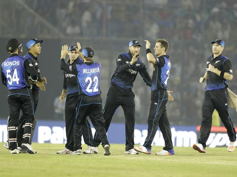 New Zealand's James Neesham, right, Matt Henry, second right, Martin Guptil, third right, and teammates celebrate the dismissal of India's MS Dhoni. (AP)