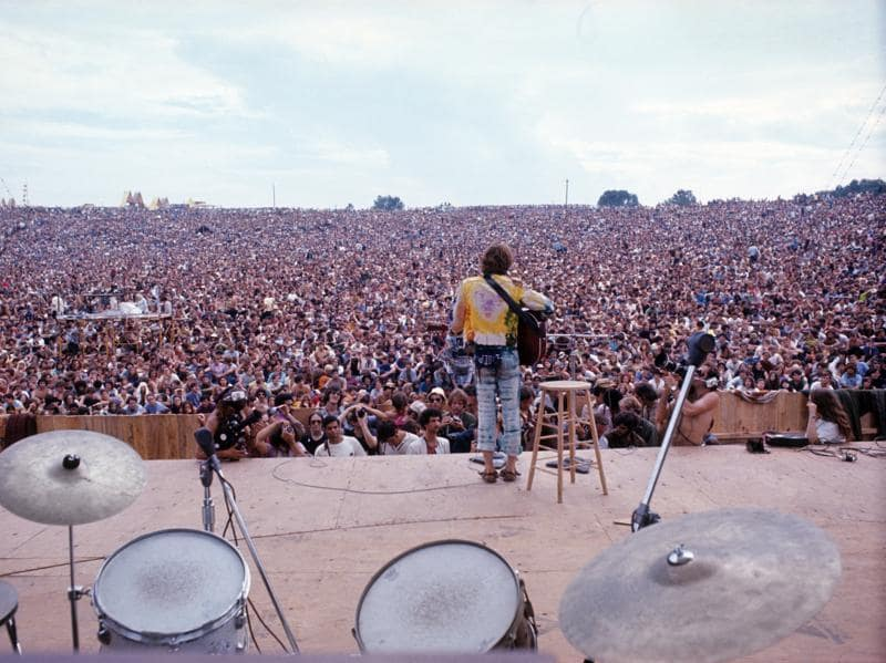 The era explored is from September 10, 2016 to February 26, 2017 when youth culture was the catalyst for an optimistic idealism, motivating people to come together and question established power structures. See here, American-born singer-songwriter and guitarist John Sebastian at Woodstock in 1969. (AFP)