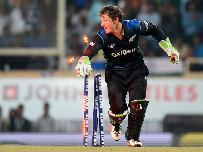 New Zealand's wicketkeeper BJ Watling runs outs India's Amit Mishra. (AFP)