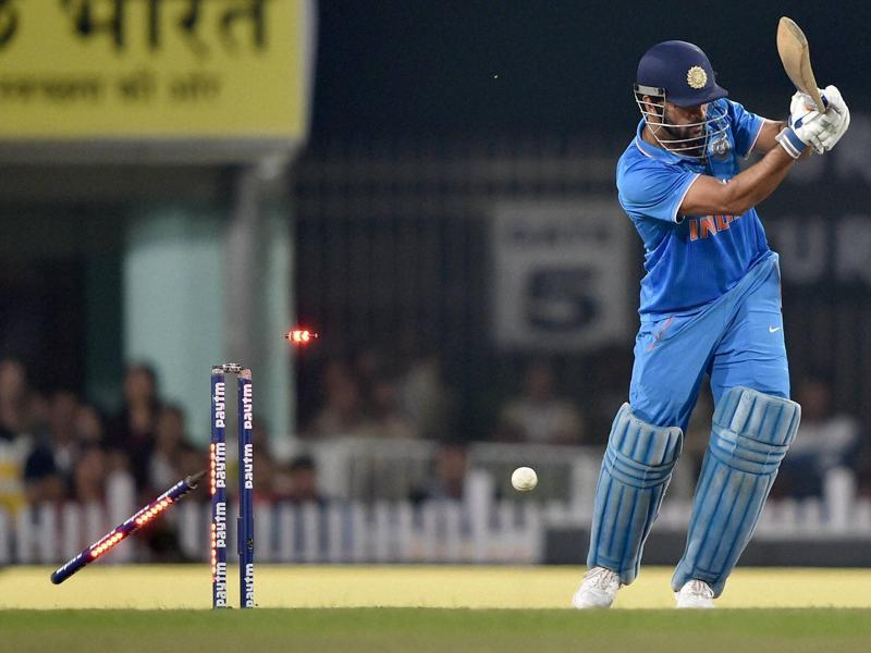 The bails fly off as MS Dhoni is bowled by James Neesham. (PTI)