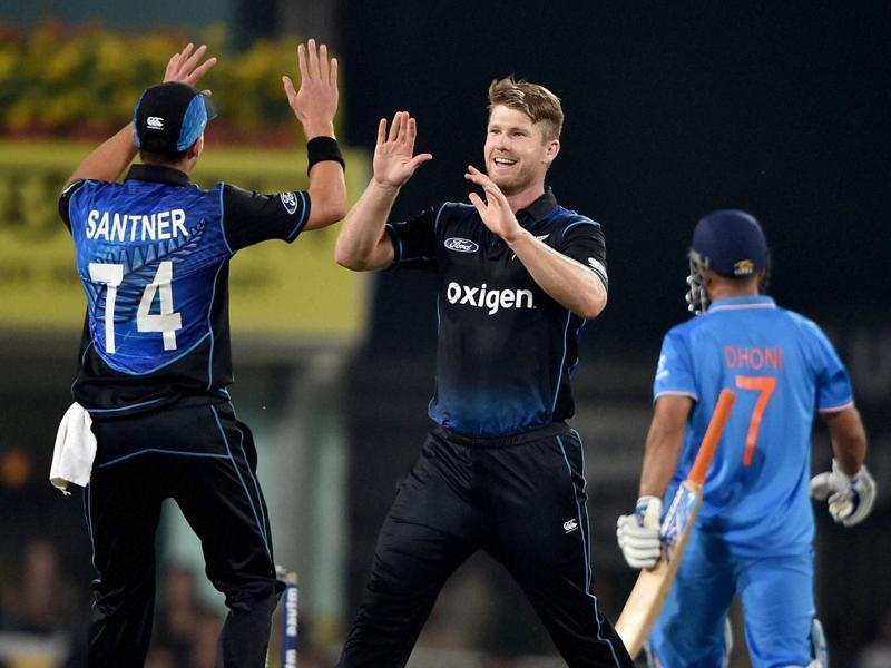 James Neesham, centre, celebrates with Mitchell Santner after dismissing M S Dhoni. (PTI)