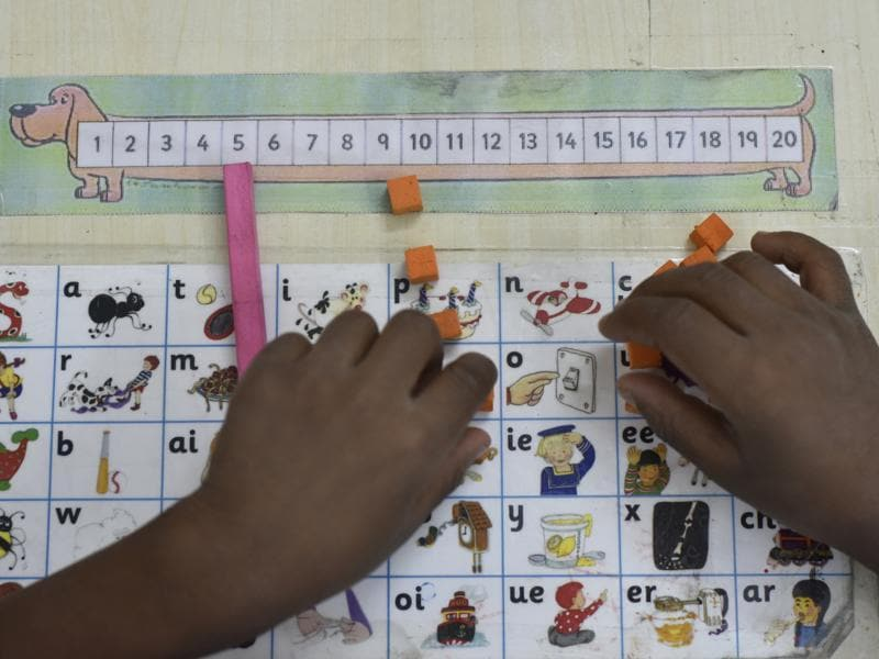 A student tries his hand on a board game.  (Vipin Kumar/HT PHOTO)
