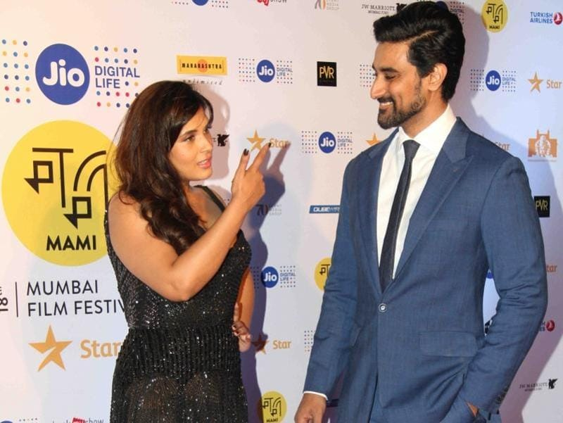 Richa Chadda and Kunal Kapoor posed for the shutterbugs ate the event. (IANS Photo)