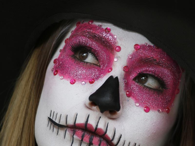 A woman with a face full of macabre make up participates in Day of the Dead festivities in Mexico City on Thursday, October 27, 2016.  (AP)