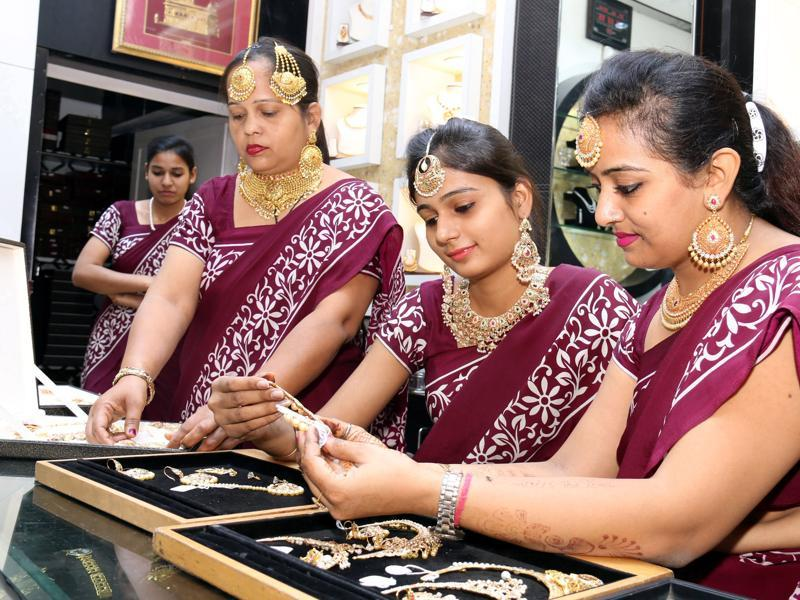 Employee busy at a jewellery shop on Dhanteras in Bathinda on Friday. (Sanjeev Kumar/HT Photo)