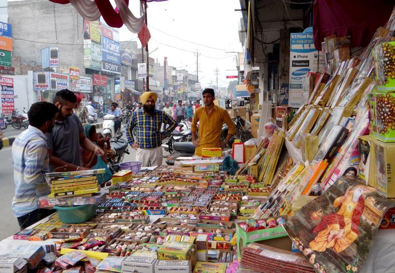 People purchasing firecrackers in Moga on Friday. (HT Photo)