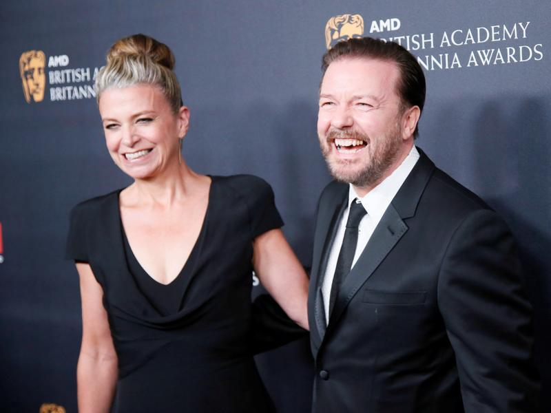 Charlie Chaplin Britannia Award for Excellence in Comedy honoree Ricky Gervais (R) and Jane Fallon pose at the British Academy of Film and Television Arts (BAFTA). (REUTERS)