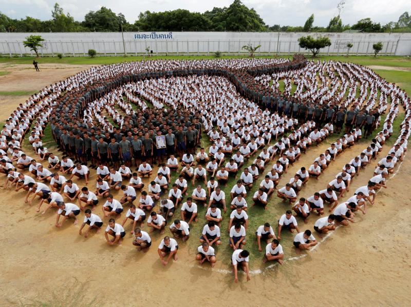 Inmates form the Thai symbol for the number nine, in honour of late Thai King Bhumibol Adulyadej, also known as King Rama IX, at the Central Correctional Institution for Young Offenders in Pathum Thani province, on the outskirts of Bangkok. (Reuters Photo)