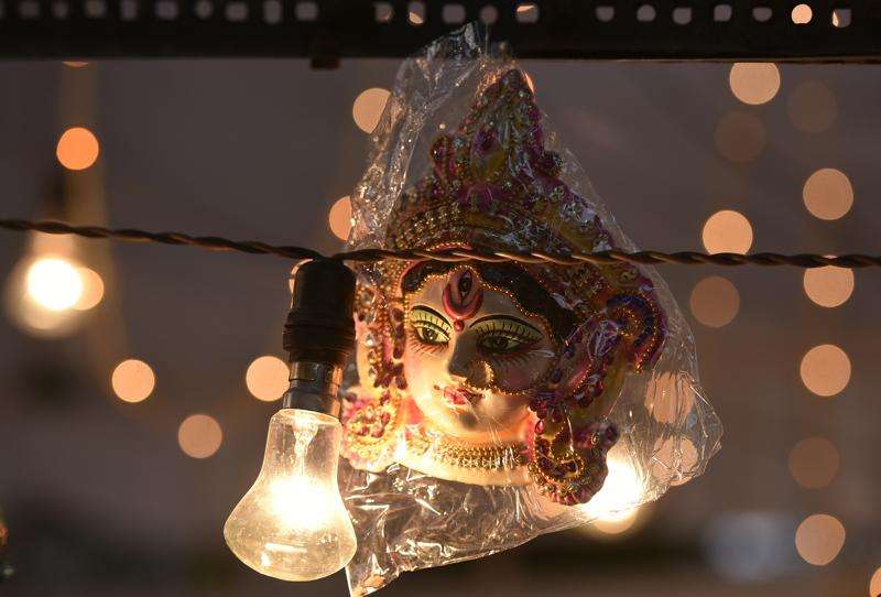 A Lakshmi idol on sale at Bengali Market in New Delhi on the occasion of Dhanteras. (Ravi Choudhary/HT Photo)