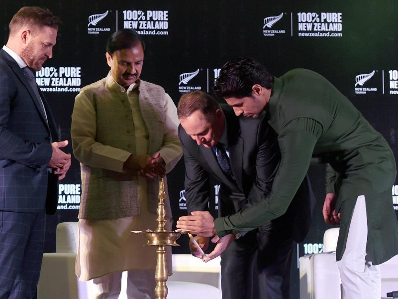 New Zealand Prime Minister John Key lights a traditional lamp as Culture and Tourism Minister Mahesh Sharma, Bollywood actor and Tourism New Zealand's brand ambassador, Sidharth Malhotra and former New Zealand Cricket Captain Brendon McCullum look on at an India- New Zealand Tourism Promotion Event in New Delhi. (PTI Photo)