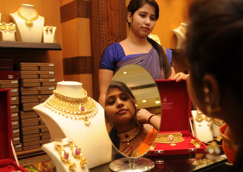 A woman tries on a necklace on Dhanteras, in Jalandhar on Friday. (HT Photo)