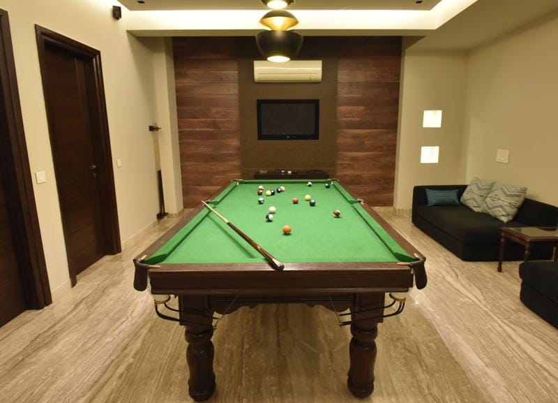 The basement has been transformed into a casual, recreational zone with the pool table and a home theatre thrown in. (Ravi Choudhary/HT PHOTO)