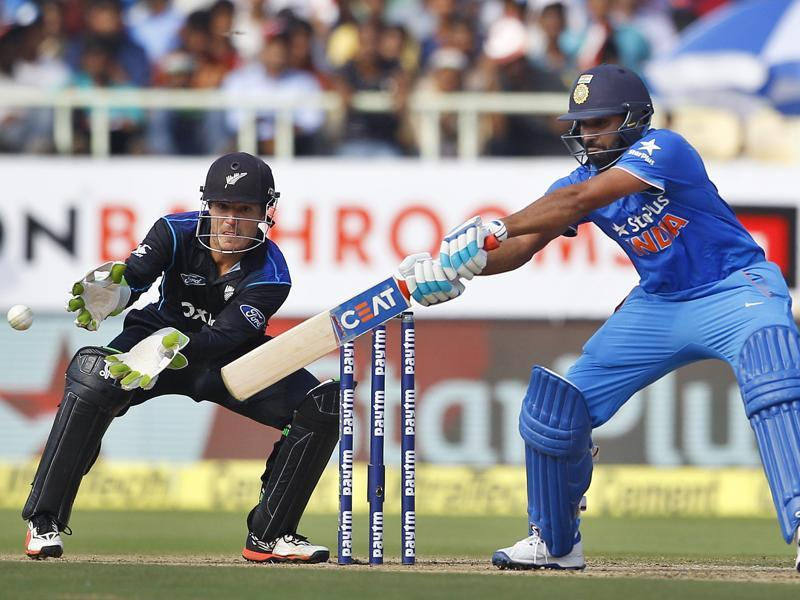 India's Rohit Sharma, right, plays a shot as New Zealand's wicketkeeper BJ Watling reacts. (AP photo)