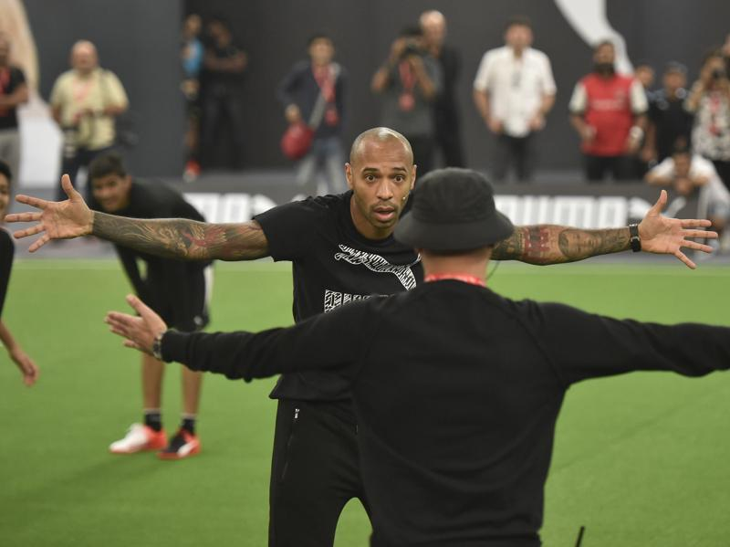 Legendary French footballer Thierry Henry shares a light moment during a brand promotion at NSCI stadium in Mumbai. (Arijit Sen/HT Photo)