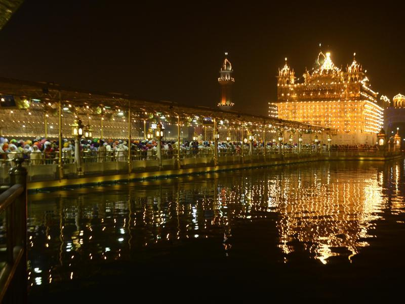 An illuminated Golden Temple on the eve of Diwali, in Amritsar. (Sameer Sehgal/HT Photo)