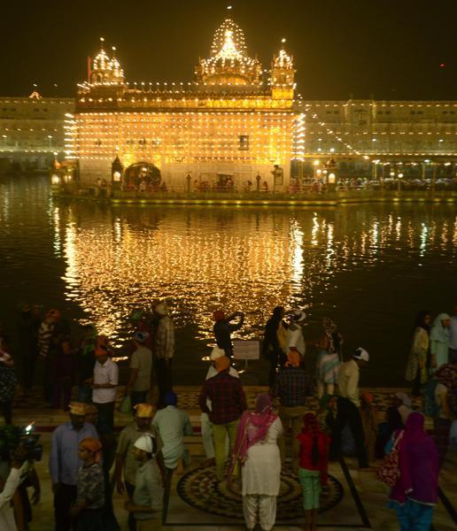 An illuminated Golden Temple on the eve of Diwali, in Amritsar on Saturday. (Sameer Sehgal/HT Photo)