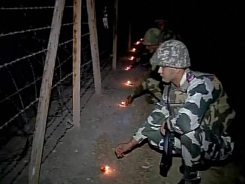 BSF jawans celebrate Diwali in RS Pura amid heightened  tensions at the borded, in Jammu on Saturday. (PTI)