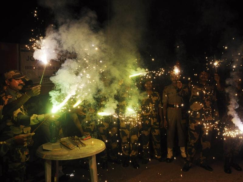 Border Security Force personnel light firecrackers to celebrate Diwali at the India-Bangladesh Akhaura checkpost in Agartala, Tripura on Saturday. (AFP)