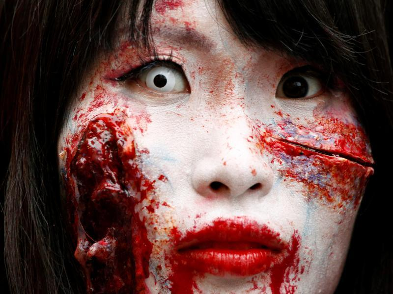 Halloween, explained simply, is a popular US family festival, where children dress up in 'frightening' costumes and visit homes demanding 'trick or treat' which is generally candies and chocolates.  A participant in costume poses for the camera after a Halloween parade in Kawasaki, south of Tokyo, Japan October 30, 2016.  (REUTERS)