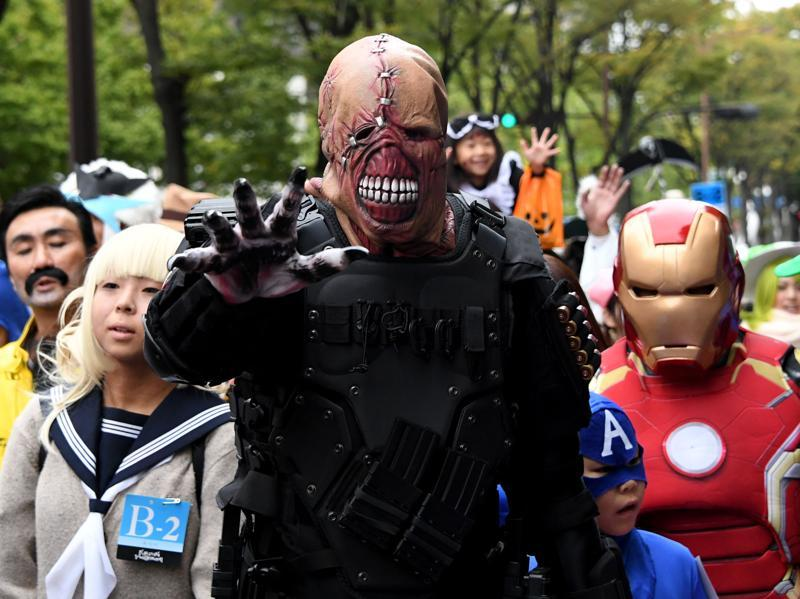 It was only in the 1950s, however, that the festival took on its current family-friendly-kids-centric form. A Kawasaki Halloween parade participant... (AFP)
