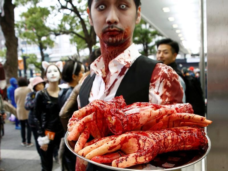 Hence, the night before became All Hallows Eve. It was later shortened to Halloween. A participant poses during the Halloween parade in Kawasaki. (REUTERS)
