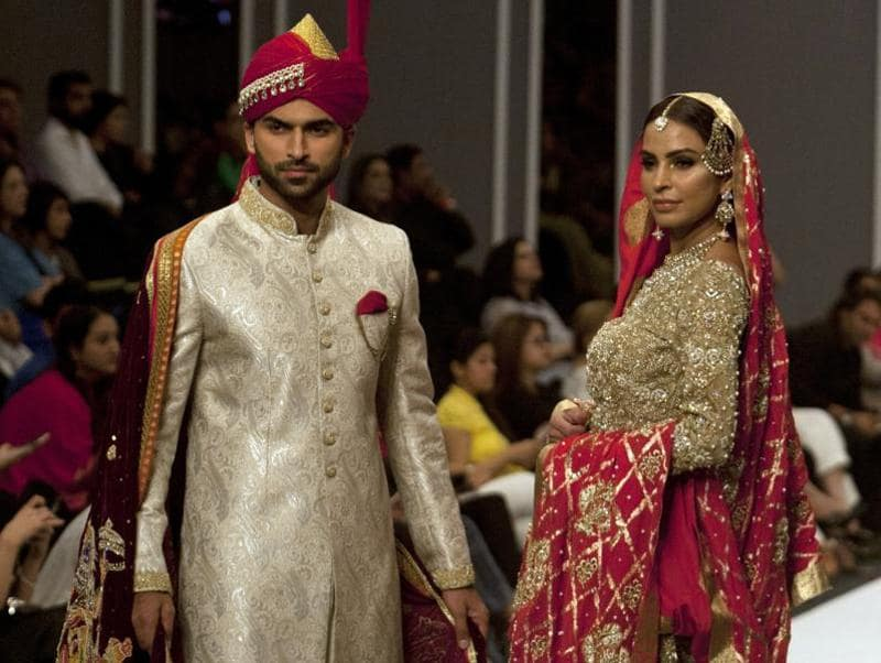 Models present creations by designer Deepak Parwani during the Fashion Pakistan Week Winter Festive 16, in Karachi, Pakistan on Monday. (AP)