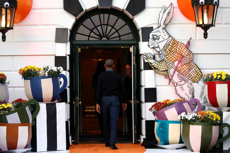 US President Barack Obama departs after giving out Halloween treats to children from the South Portico of the White House in Washington, US. (Reuters Photo)