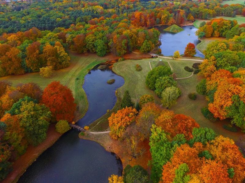 An aerial view taken with a drone shows the autumnally colored Fuerst-Pueckler-Park near Cottbus, eastern Germany.  The park,  built in the 19th century by Prince Hermann von Pueckler-Muskau, is considered as one of the last great German landscape gardens. (Patrick Pleul/dpa via AP)