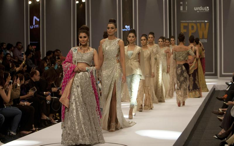 Models present creations from designer Rozina Munib during the