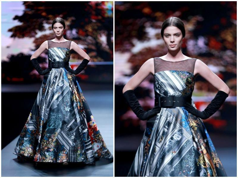 Another model parades a creation from AM.IXAM Collection designed by Ying Ma. (AFP)