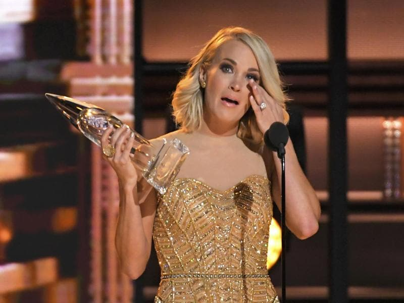 Carrie Underwood wipes her eyes as she accepts the award for female vocalist of the year at the 50th Annual Country Music Association Awards. (REUTERS)