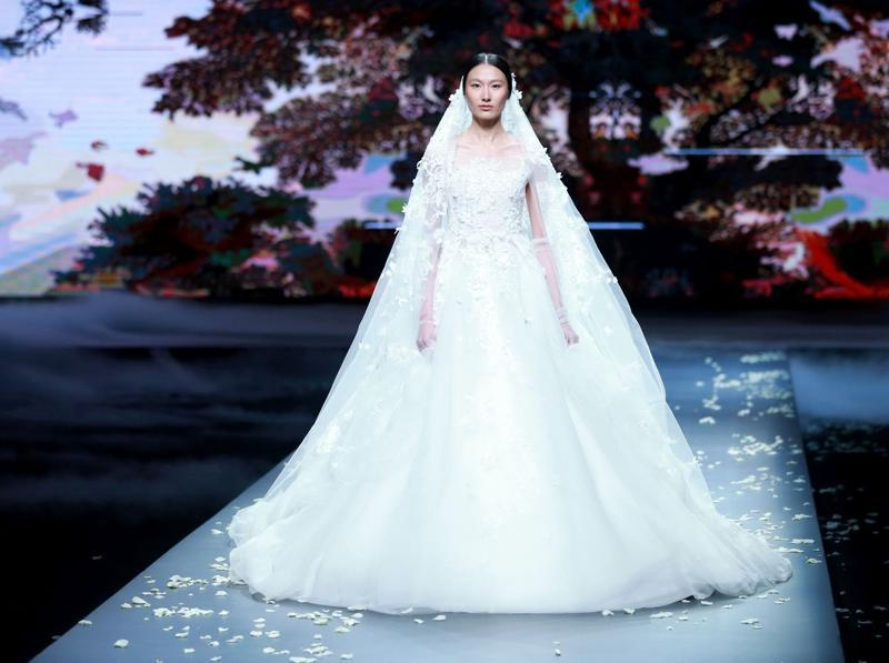 Gown dreams became reality on the China Fashion Week ramp. See models instantly transform into the princesses /queens they've always wanted to be.  (AFP)