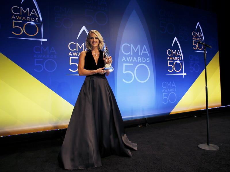Singer Carrie Underwood poses backstage with her award for Female Vocalist of the Year during the 50th Annual Country Music Association Awards in Nashville. (REUTERS)