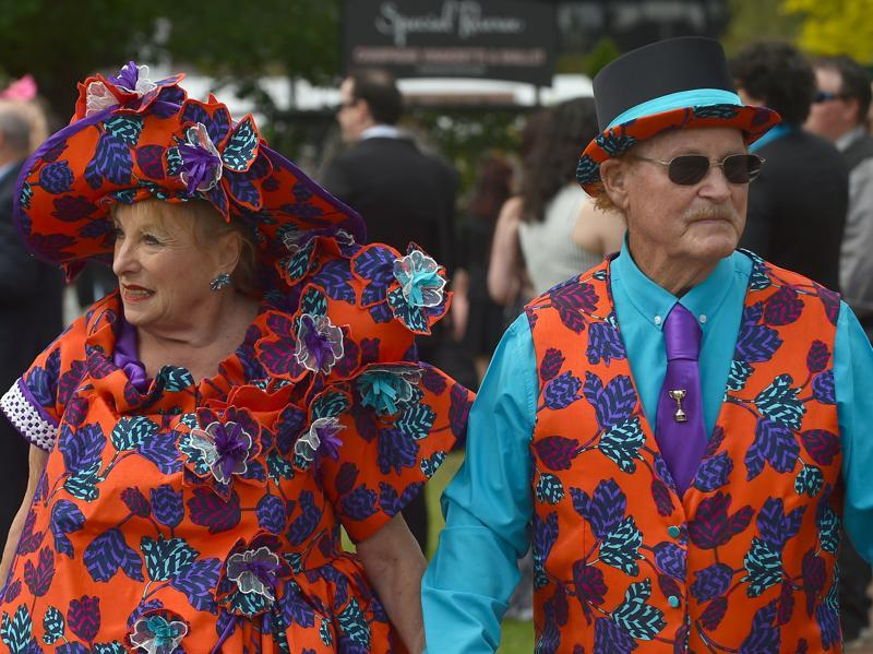 When the mood is right, age is hardly a concern -- racegoers arrive for the event. (AFP)