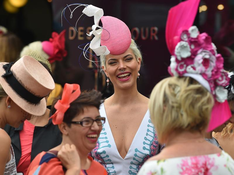 'Fashion on the Field' competitors share a laugh at Flemington Racecourse. Don't miss her nose ring... (AFP)