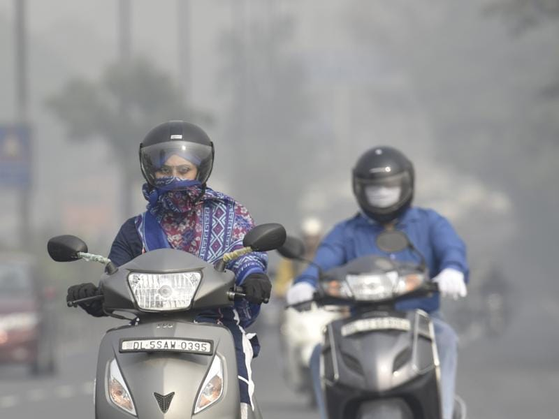 For people who commute by two-wheelers, buses, or by walk, the smog is almost inescapable.   (Raj K Raj/HT PHOTO)