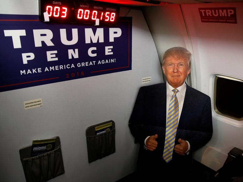 A cardboard cutout of Republican presidential nominee Donald Trump is pictured on a the media charter plane with a countdown clock to the election while sitting on the tarmac at the airport in Tampa, Florida. (REUTERS)
