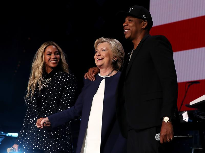 Beyonce, Democratic presidential nominee former Secretary of State Hillary Clinton and Jay Z appear on stage during a Get Out The Vote concert at Wolstein Center on November 4, 2016 in Cleveland, Ohio.  (AFP)