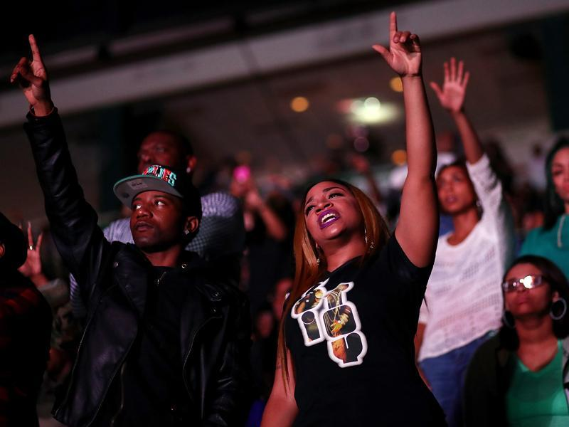 Attendees dance as Jay Z performs during a Get Out The Vote concert Democratic presidential nominee former Secretary of State Hillary Clinton at Wolstein Center. (AFP)