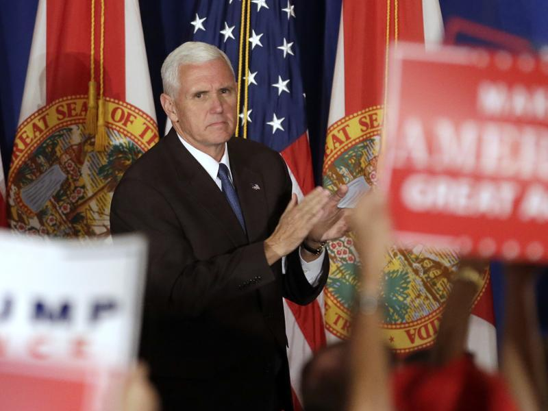 Republican vice presidential candidate Indiana Governor Mike Pence acknowledges supporters as they chant pro Trump slogans at the campaign rally. (AP)