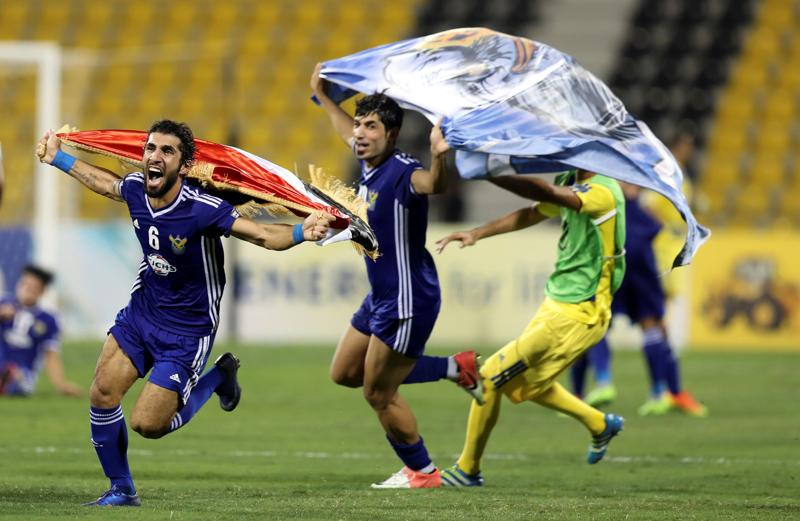 FThe Iraq Air Force Club players celebrated after the final whistle was blown, almost eight minutes of stoppage time. (REUTERS)