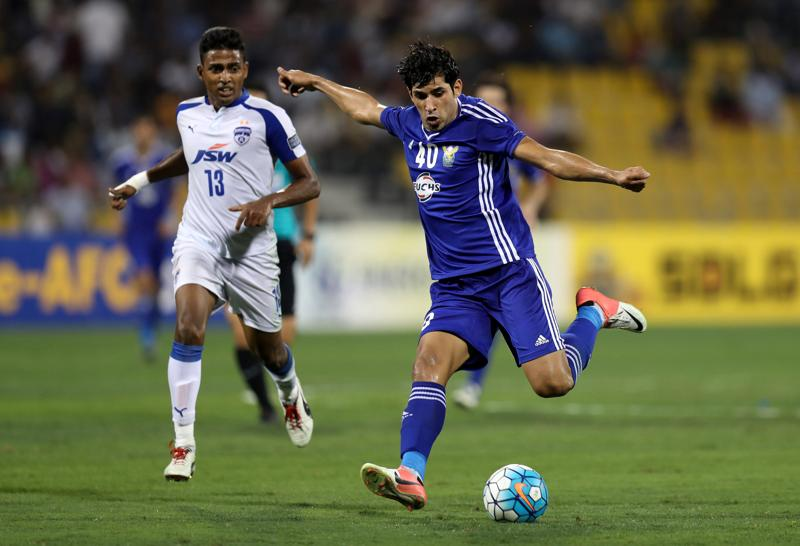 Bengaluru FC's Rino Anto fights for the ball with Amjad Radhi of Iraq's Air Force Club in what proved to be a dull first half. (REUTERS)