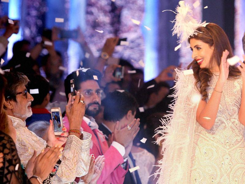 A rare family moment was seen by everyone present at the launch of a new international line by fashion designers Abu Jani and Sandeep Khosla in Mumbai on Friday. Megastar Amitabh Bachchan was a proud father at the event, cheering for his daughter Shweta Bachchan Nanda, who walked the ramp for the designer-duo. (PTI)