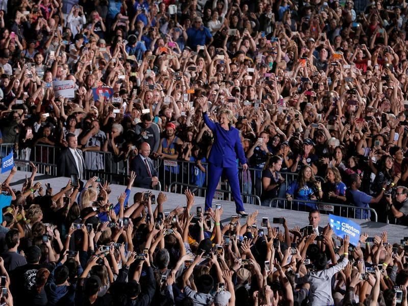 In the White House race, the winner needs at least 270 of the 538 electoral votes up for grabs. Here the US Democratic presidential nominee Hillary Clinton takes the stage at a campaign rally at Arizona State University in Tempe, on November 2, 2016.   (REUTERS Photo)