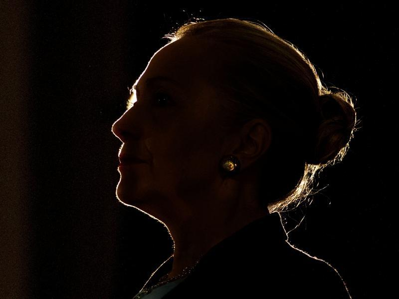 Hillary Clinton became New York's senator in 2001 and remained in the post till 2009. Here she is silhouetted by a stage light as she speaks at the University of the Western Cape about the US-South Africa partnership, in Cape Town on August 8, 2012.  (REUTERS Photo)