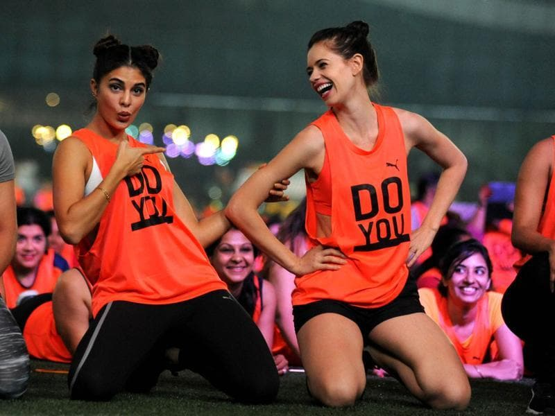 Jacqueline Fernandez and Kalki Koechlin participate in a challenge that attempted to break a world record for the most people holding an abdominal plank to mark International Day of the Girl Child in Mumbai. (AFP Photo)