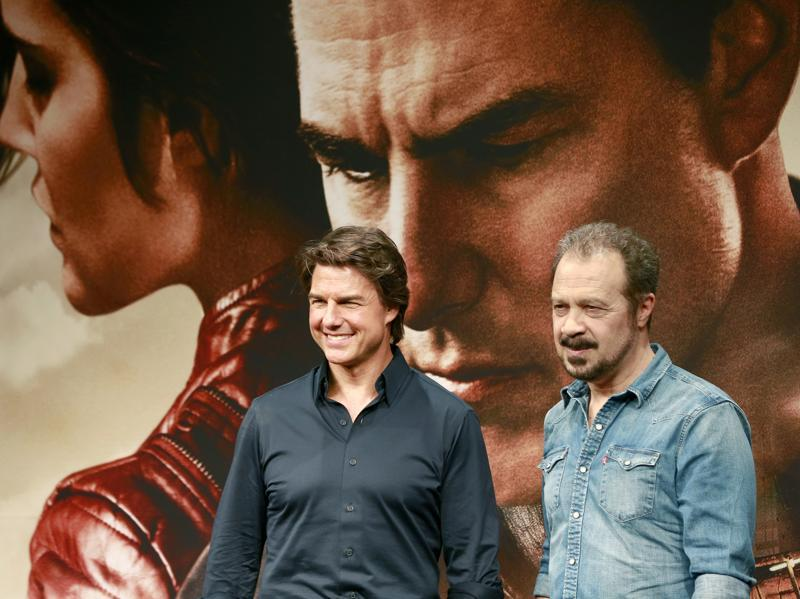 Actor Tom Cruise, left, and director Edward Zwick pose for photographers during a press conference to promote Jack Reacher: Never Go Back in Tokyo. (AP)